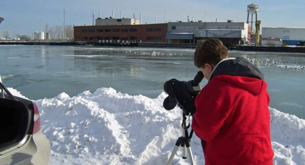 Aaron looking for uncommon ducks and gulls at Waukegan Harbor on the Lake Michigan shore. He found a Long-tailed Duck at this site.